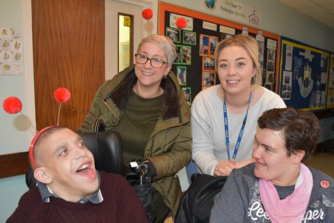 students and staff smiling