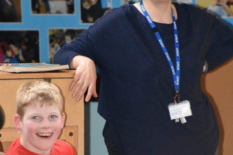 teacher wearing a blue wig