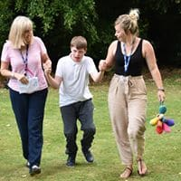 Student walking to collect award