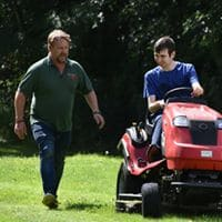 Student learning to cut the grass