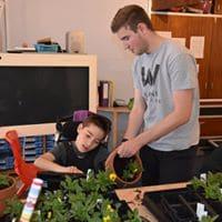 Student potting plants