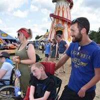 Students looking at rides at Womad
